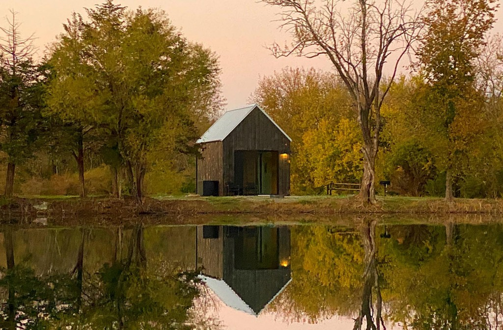Photo of a cabin on the water at Base Camp in Humboldt, Kansas.