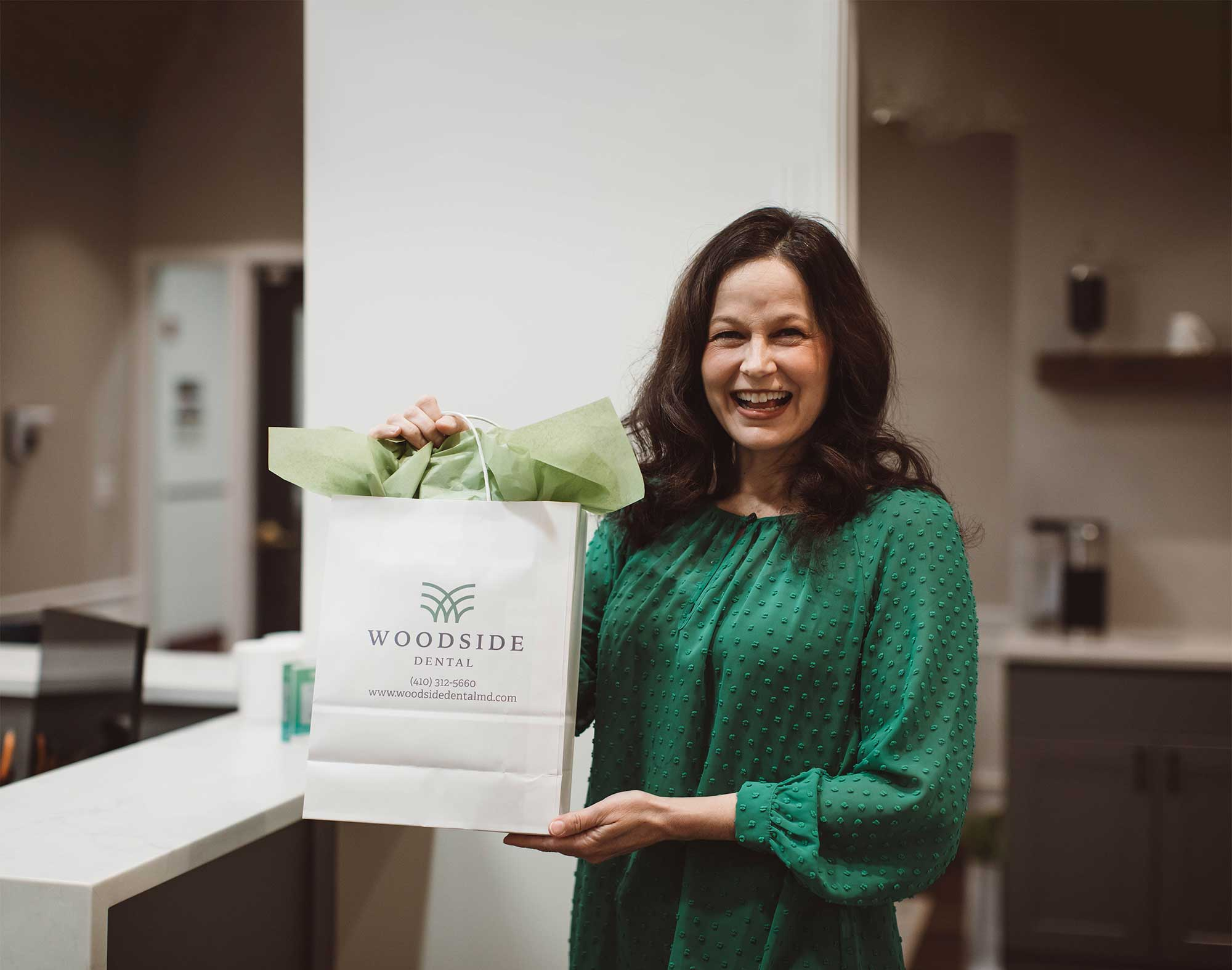 Photo of a patient holding a gift bag from the Woodside team