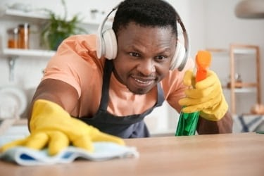 Man cleaning while listening to music