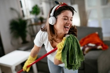 Woman singing while cleaning