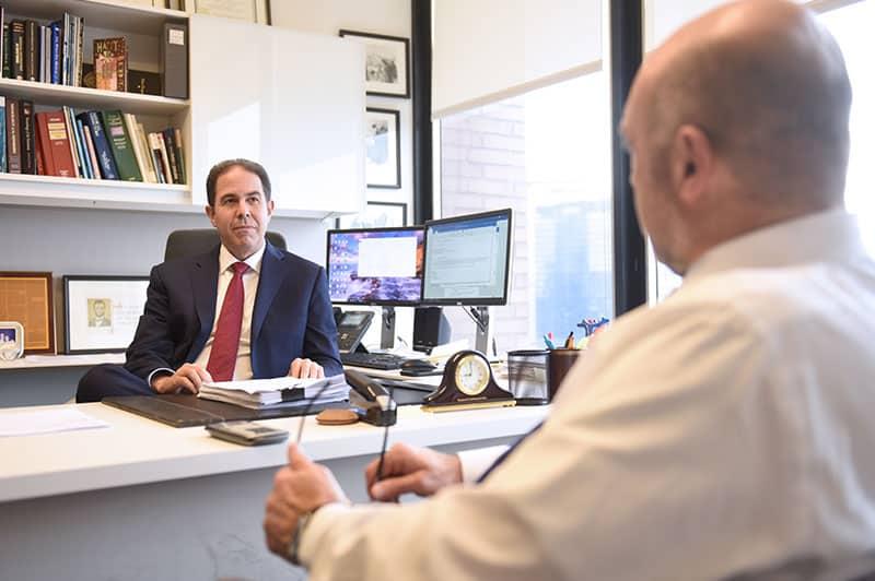 Bradley Zimmerman at Jacob Fuchsberg Law Firm office
