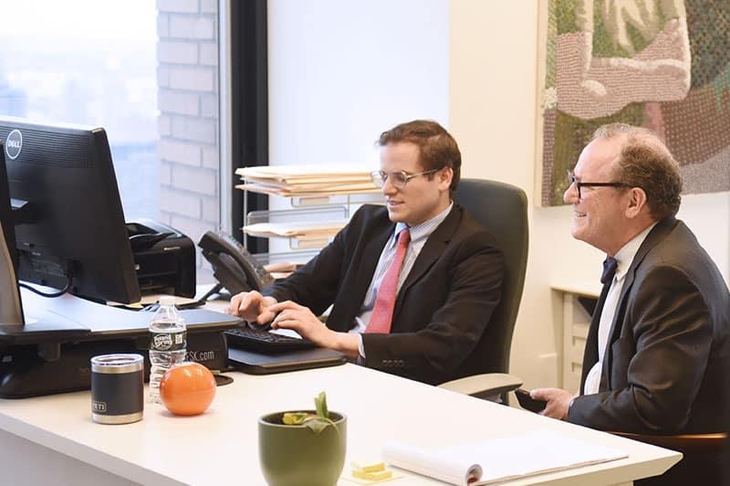 Eli Fuchsberg and Alan Fuchsberg at law firm office