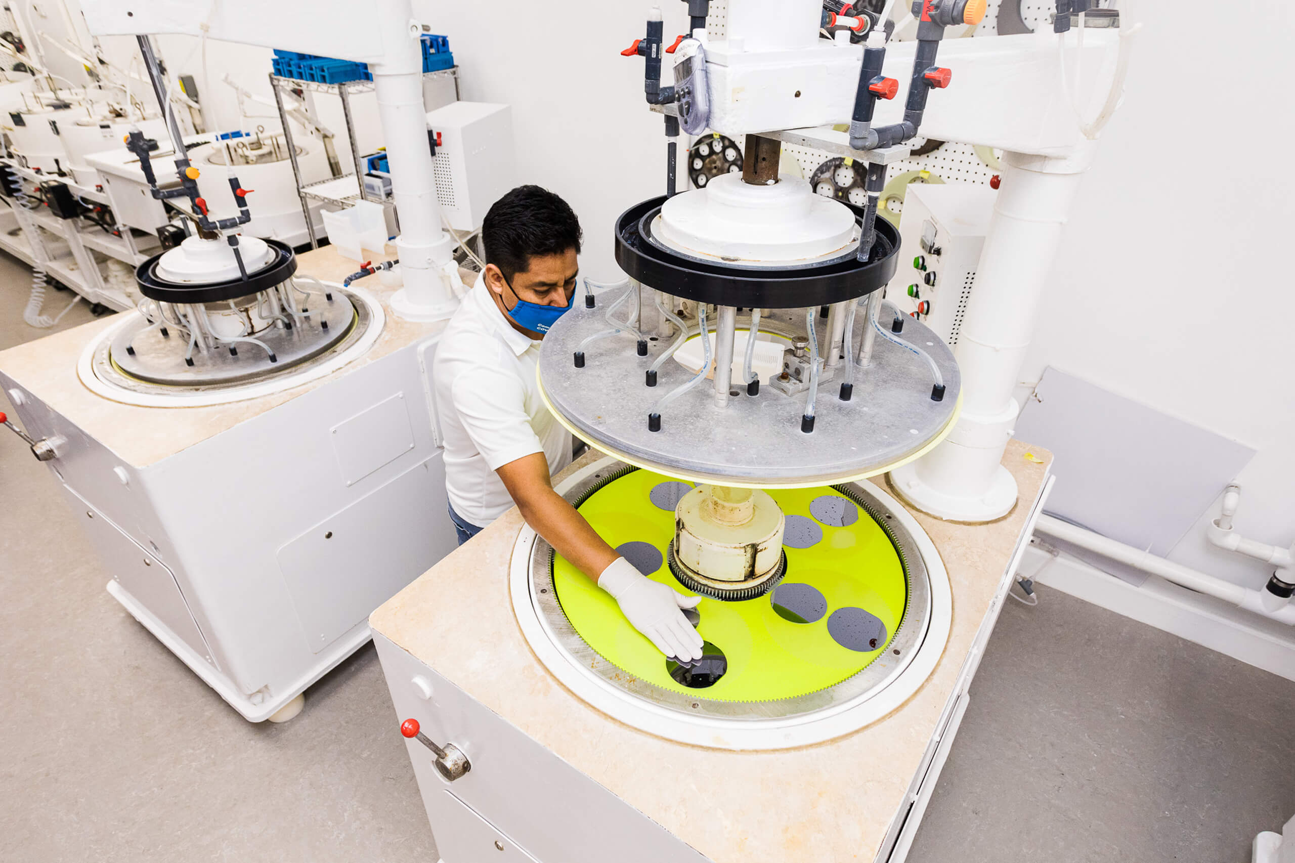 Wafer manufacturer inspecting the wafers individually.