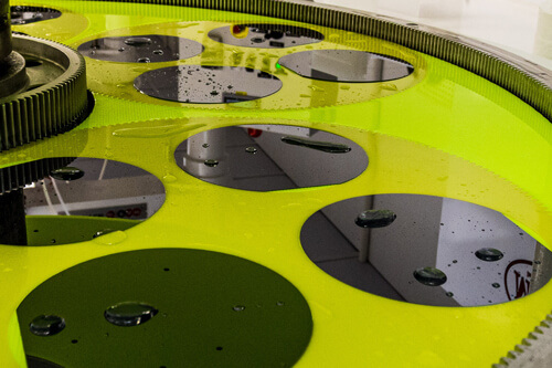 Row of silicon wafers during the manufacturing process.