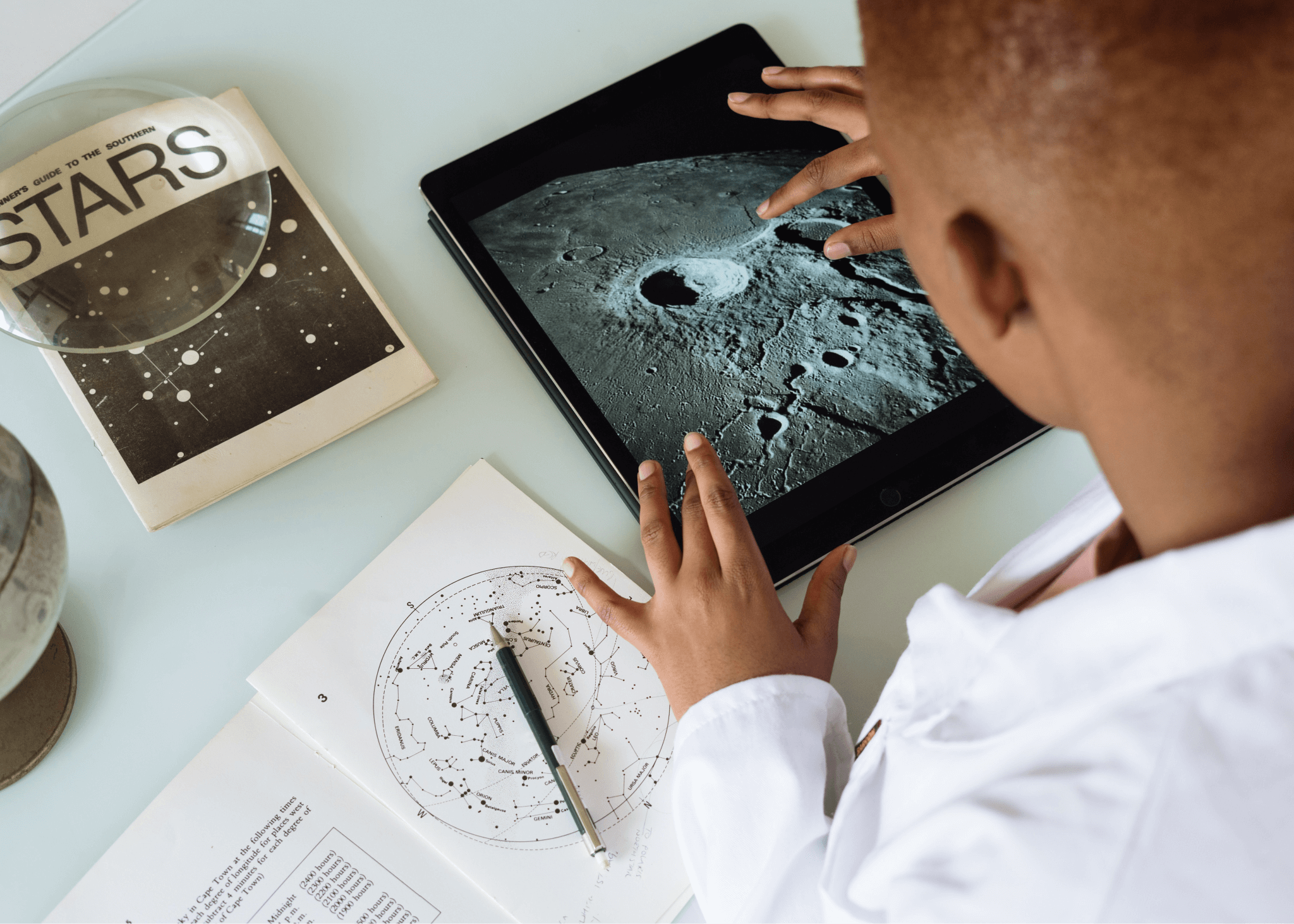 Child studying space on tablet
