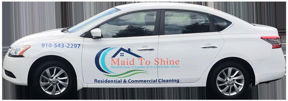 A white Maid to Shine vehicle.