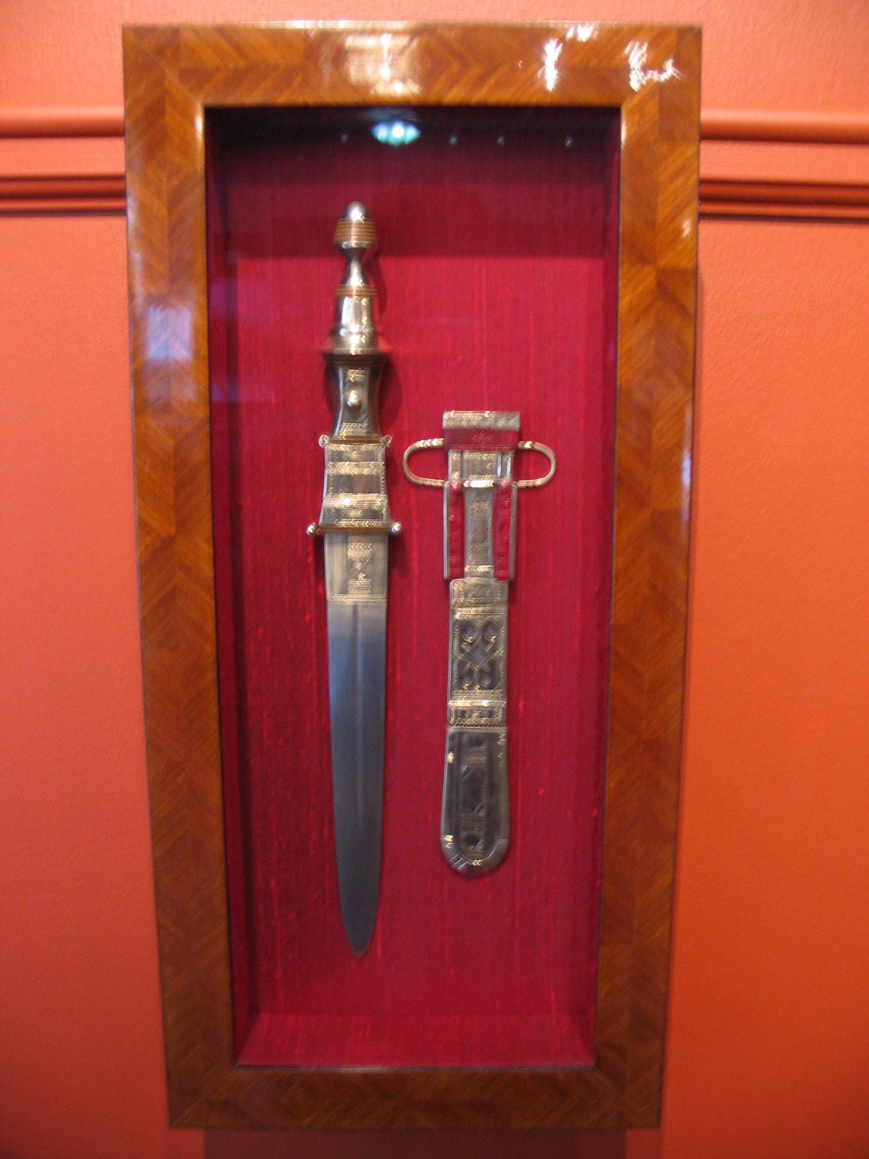 Sword and belt framed by The Framemakers