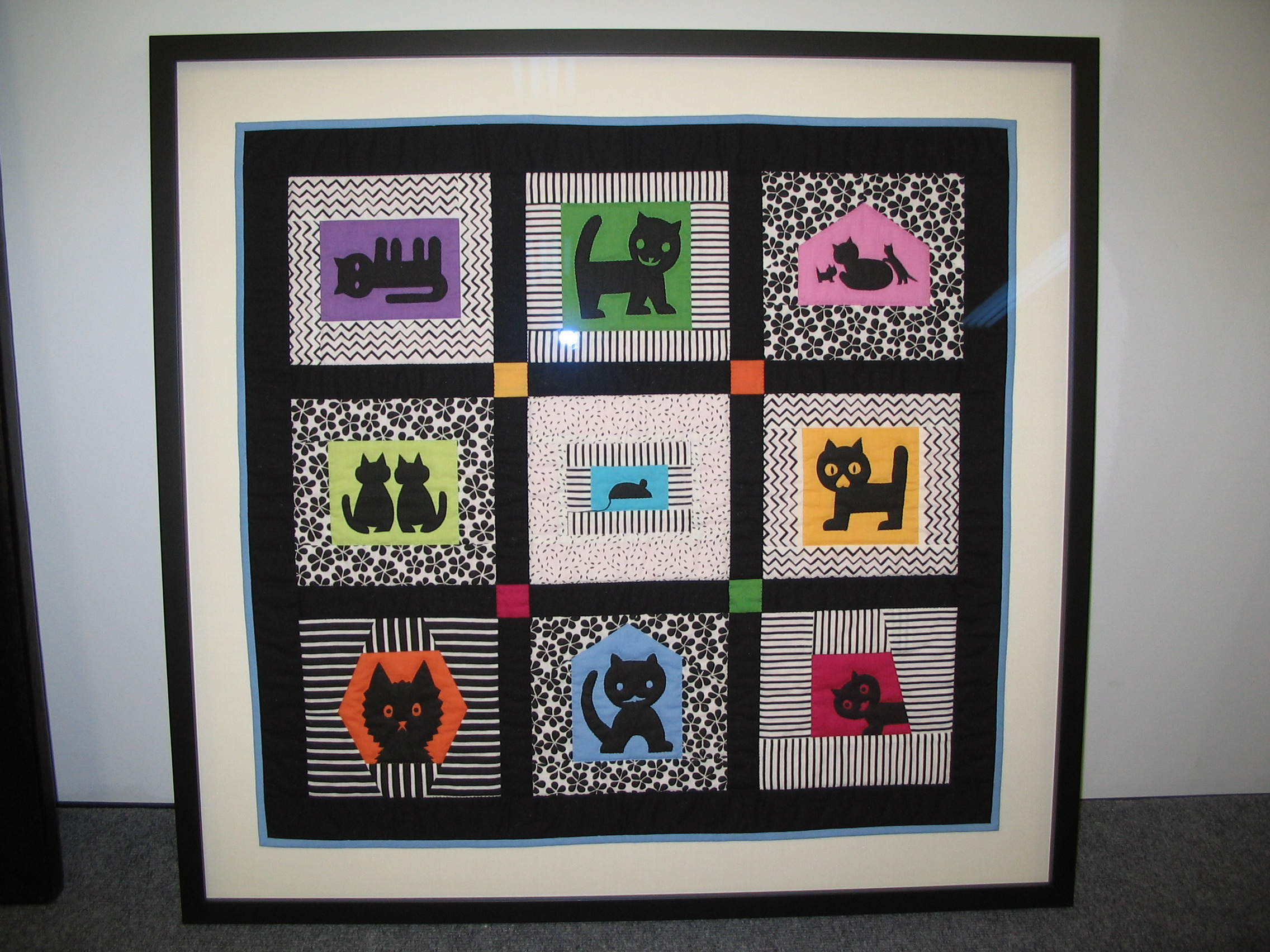 Cats framed by The Framemakers