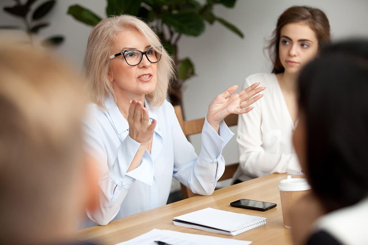 Female business coach with businesswomen.