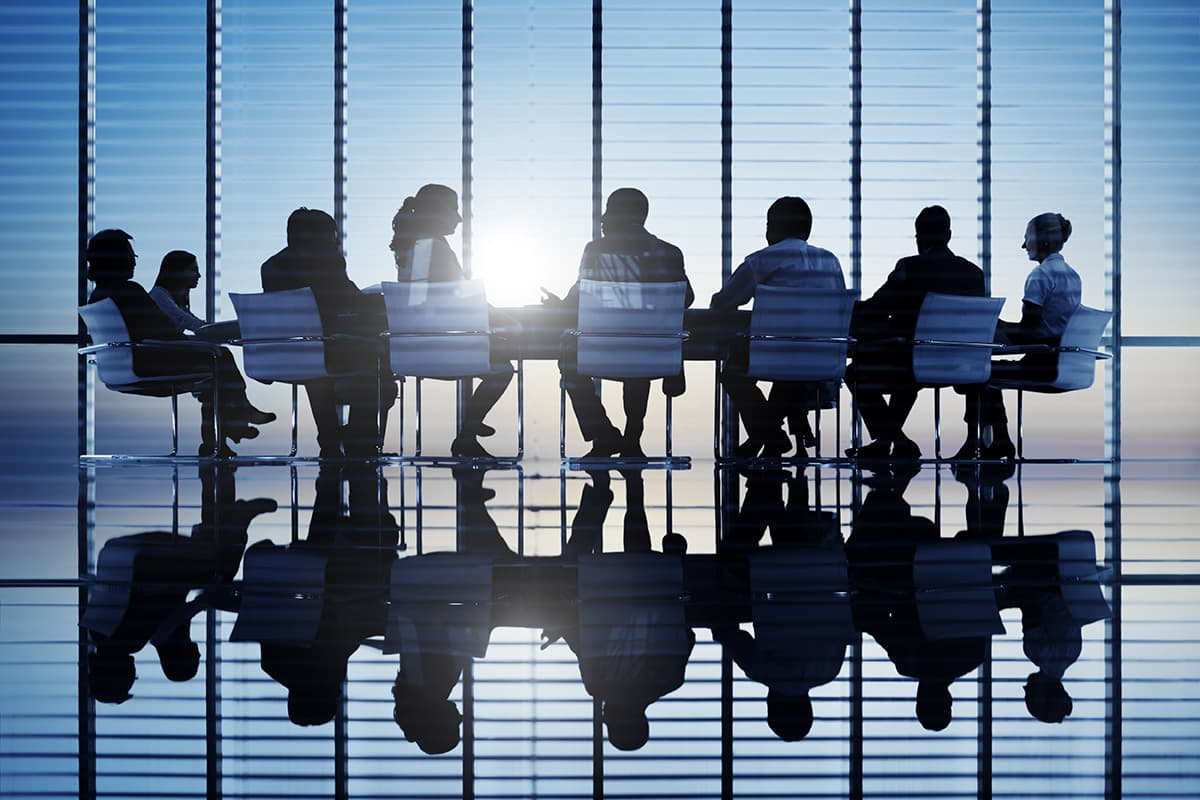 A group of businessmen sitting at a table.