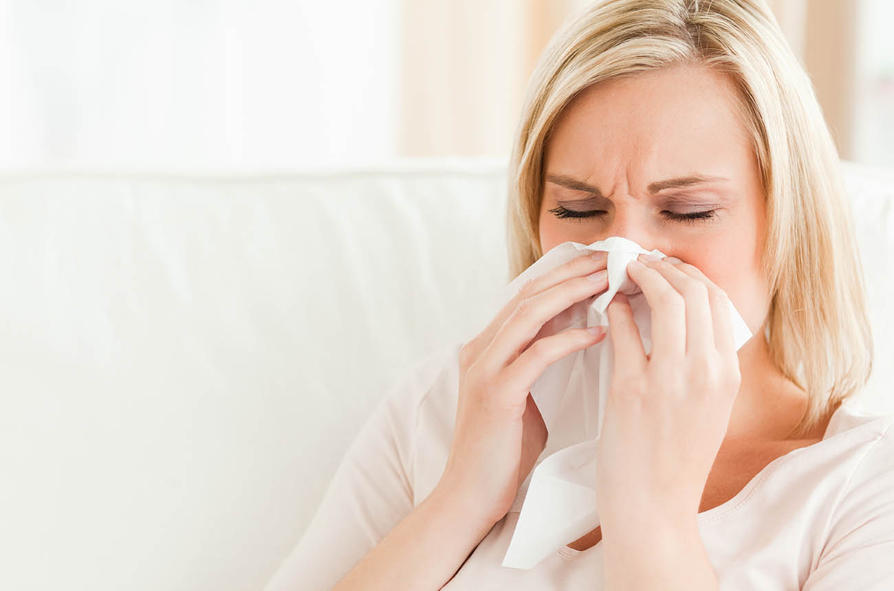 Lady With Sinus Pain Sneezing