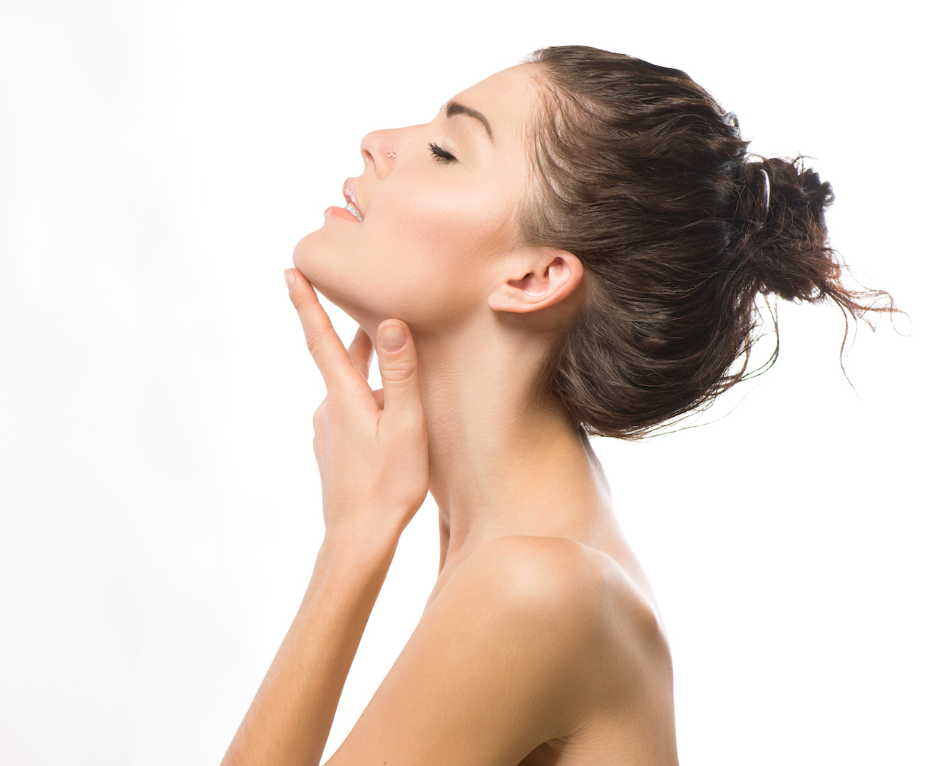 woman with head back touching neck