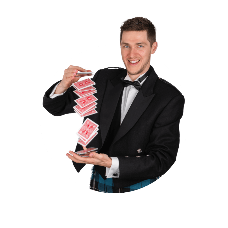 David Deanie performing a magic trick with a pack of red playing cards