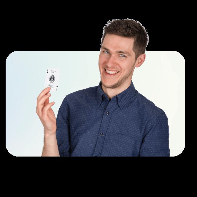 David Deanie, a magic teacher, looking ahead smiling