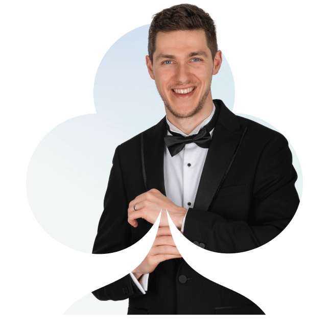 A magician in black tie smiling