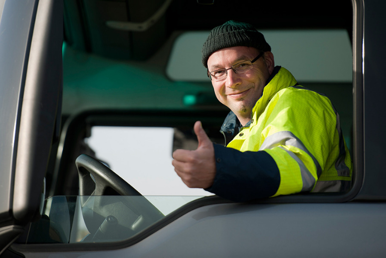 Happy trucker with a thumbs up