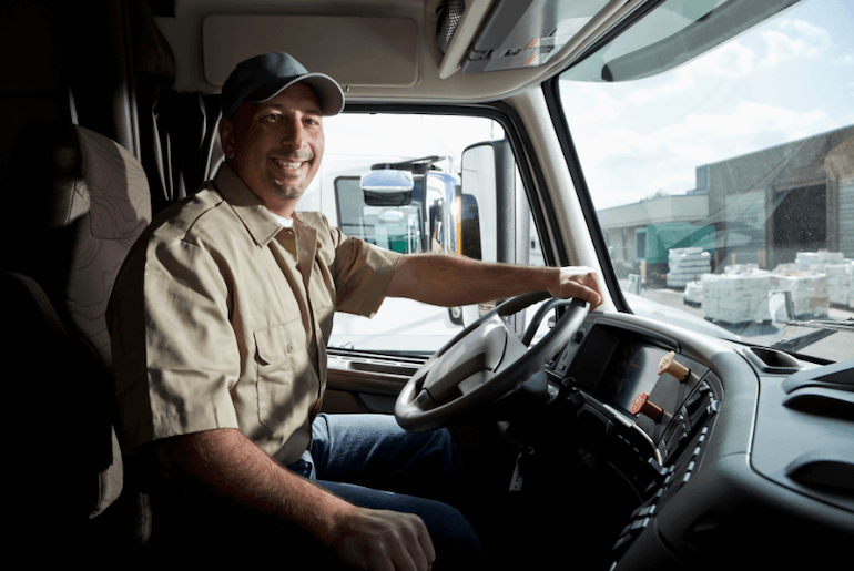 Smiling driver in a truck