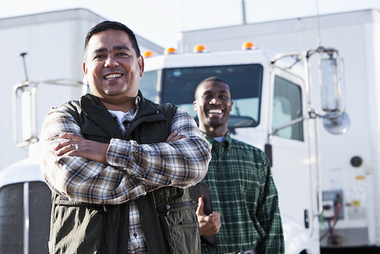 Two smiling truck drivers