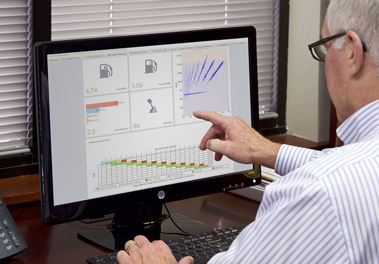Man looking at data on a computer
