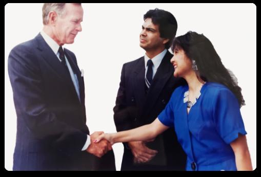 41st President George W. Bush shaking hands with Lorri Galloway