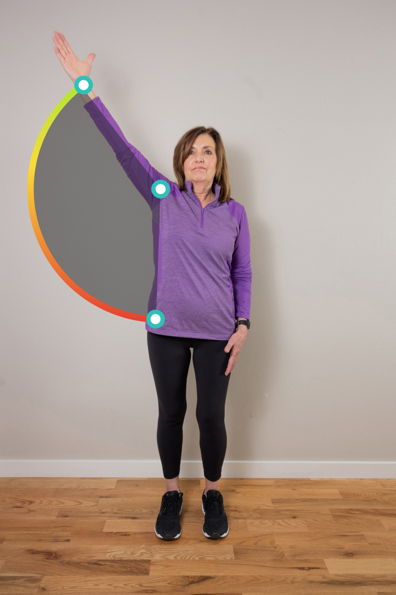 Women does physical therapy range of motion exercise at home using Exer Physio, a digital therapeutics mobile app for at home physical therapy.