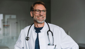 A smiling male doctor