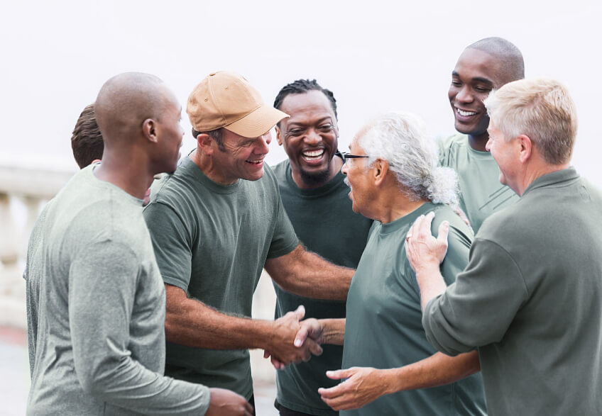 Men congratulating another man