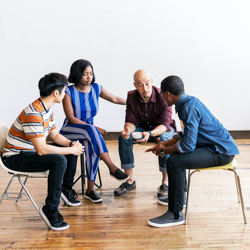 group talking on chairs