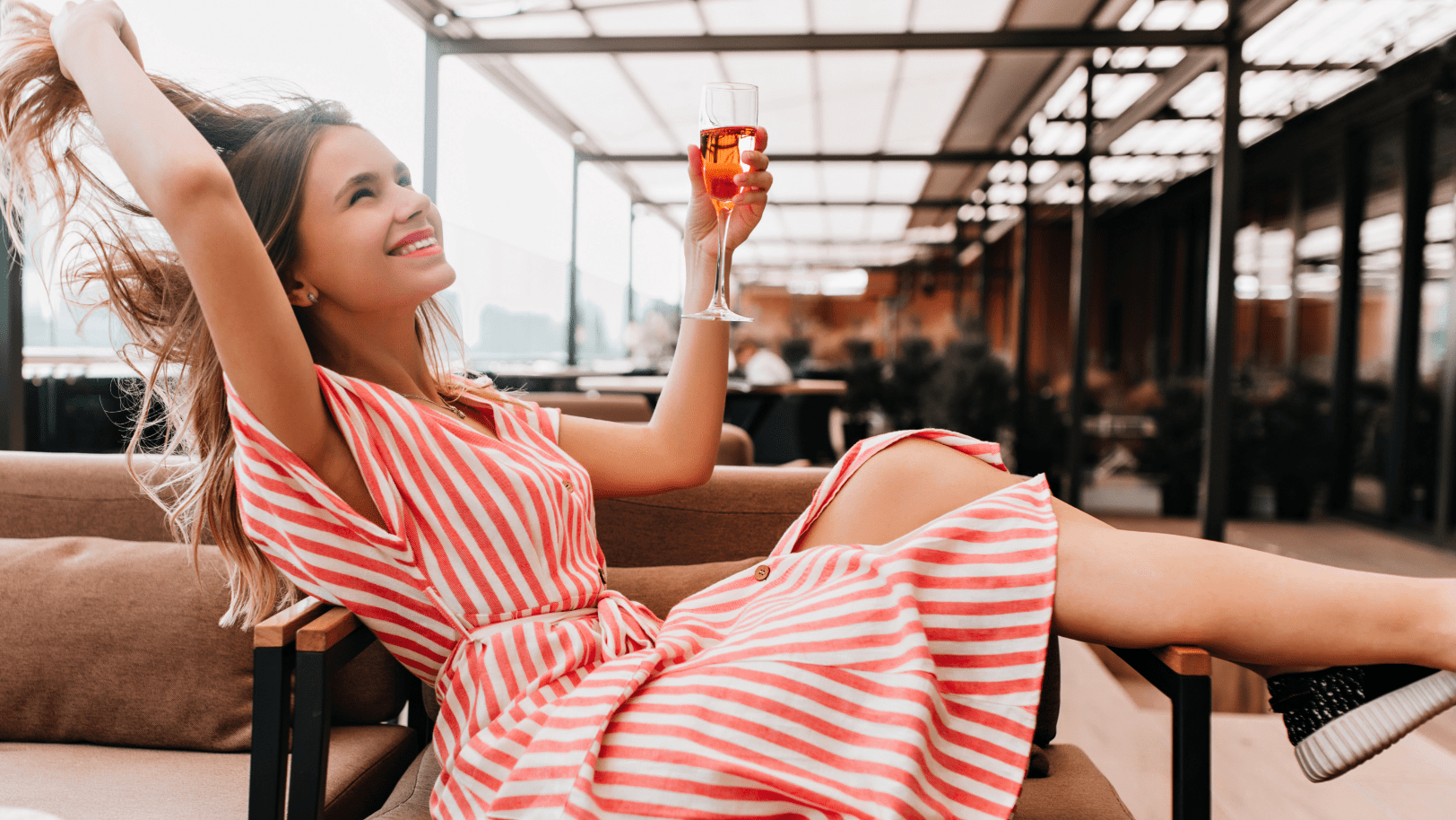 Woman with wine glass posing for photo