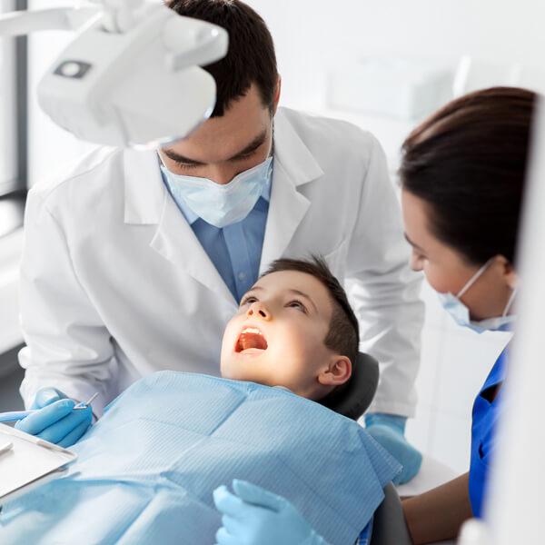 Dentist with child patient