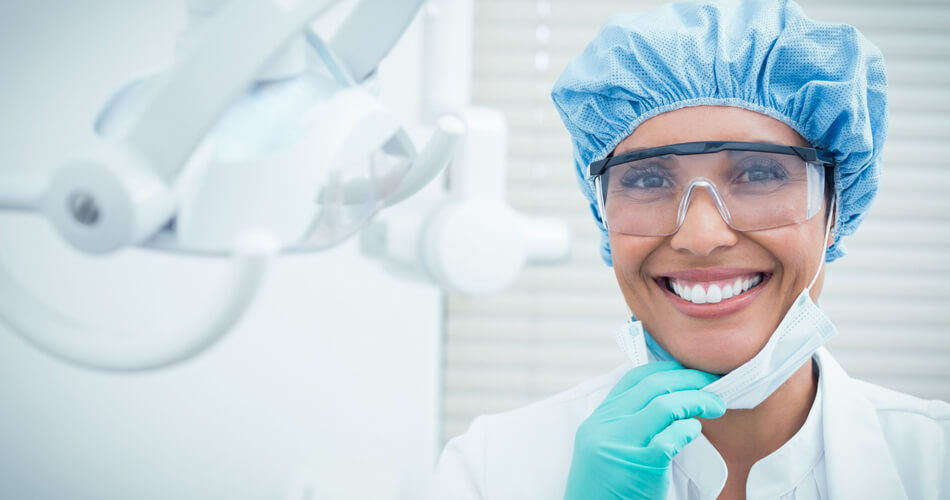 Dentist smiling after oral surgery