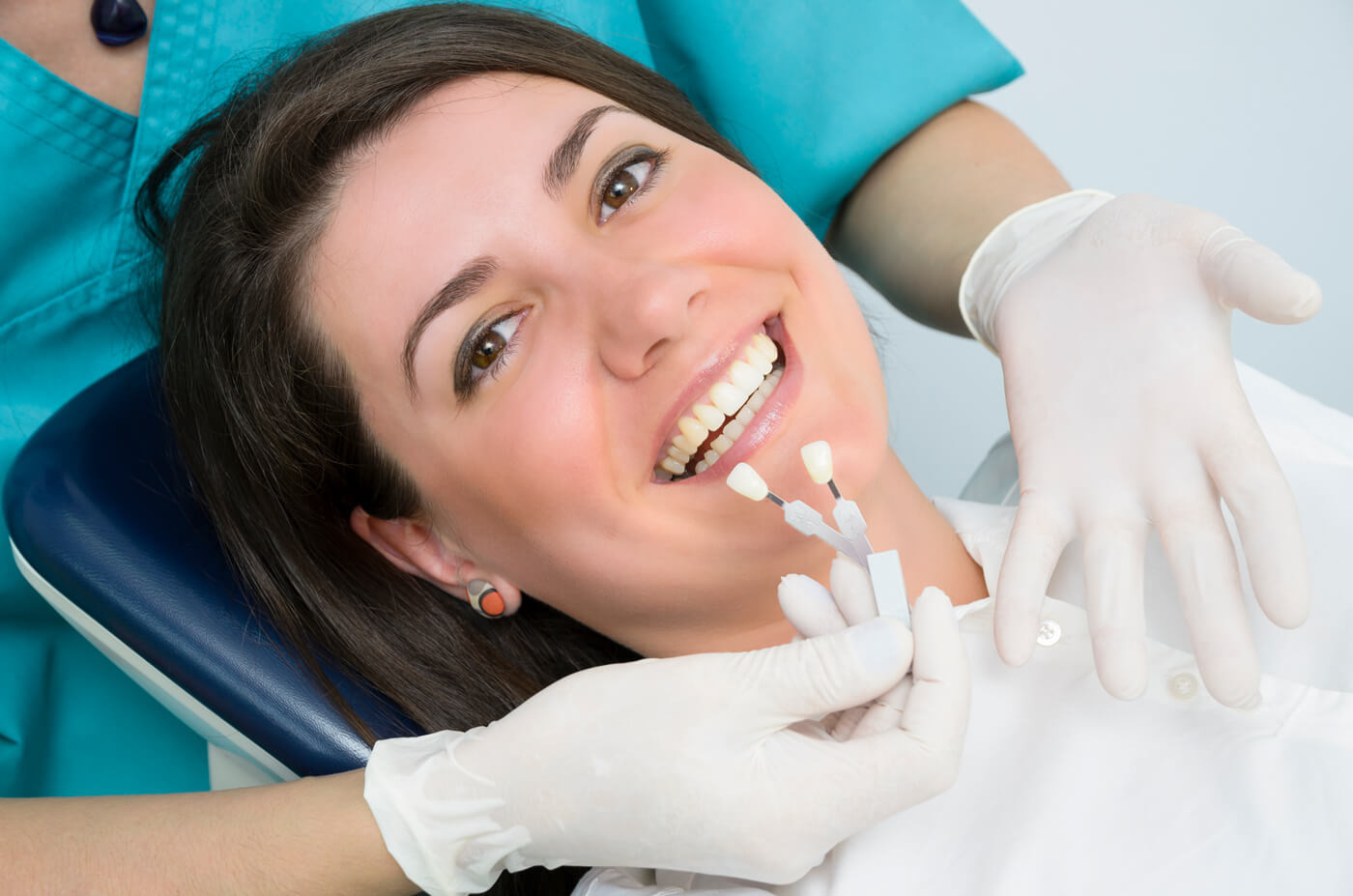 Dentist matching tooth color for inlays and onlays