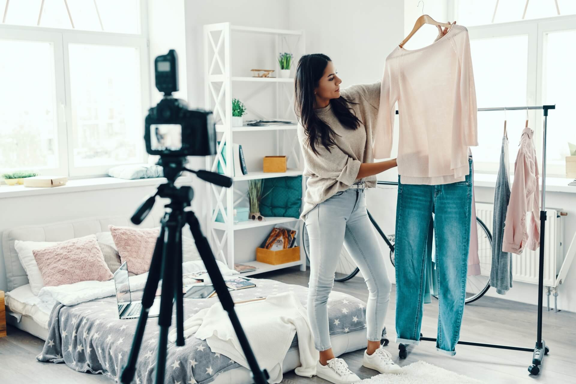 Influencer films herself putting together a potential outfit