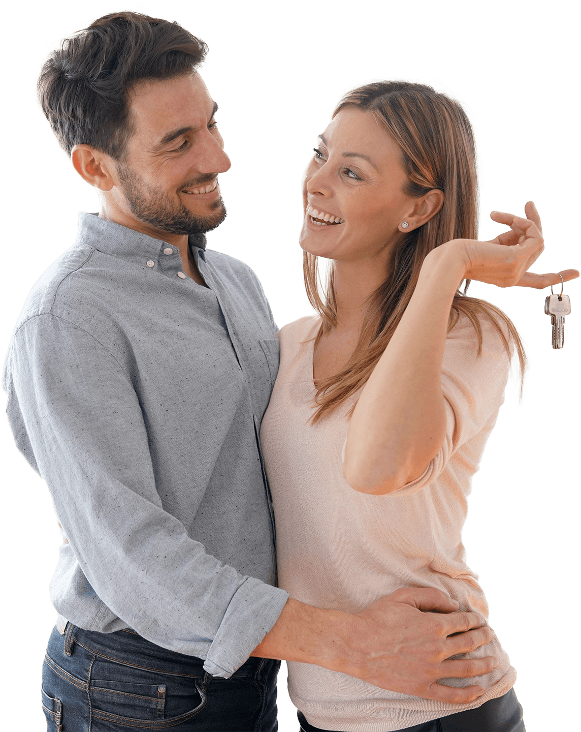 Young couple looking happy with pair of keys in their hand as they've sold their property