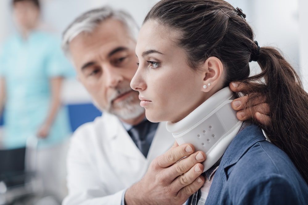 patient gets fitted with a neck brace