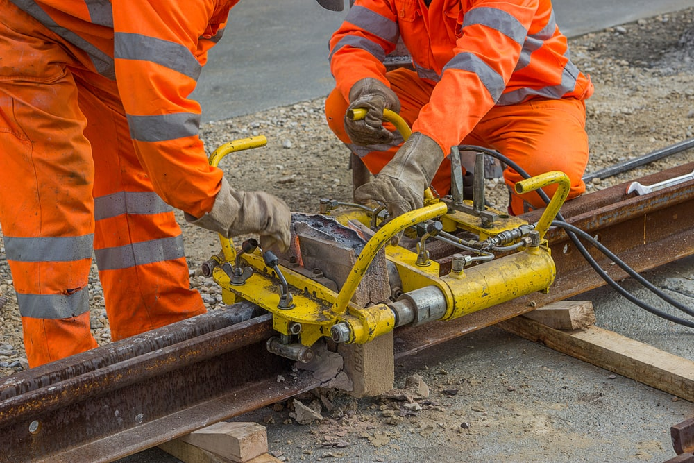 construction workers working on a rail