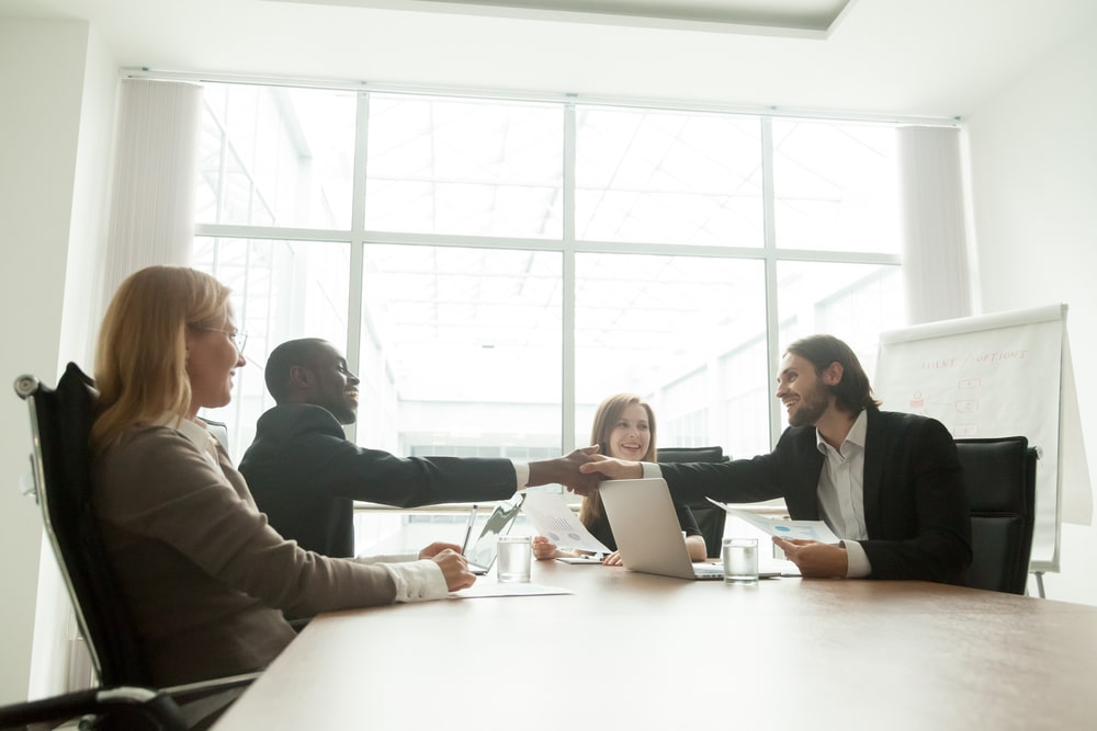 a group of professionals meeting around a table