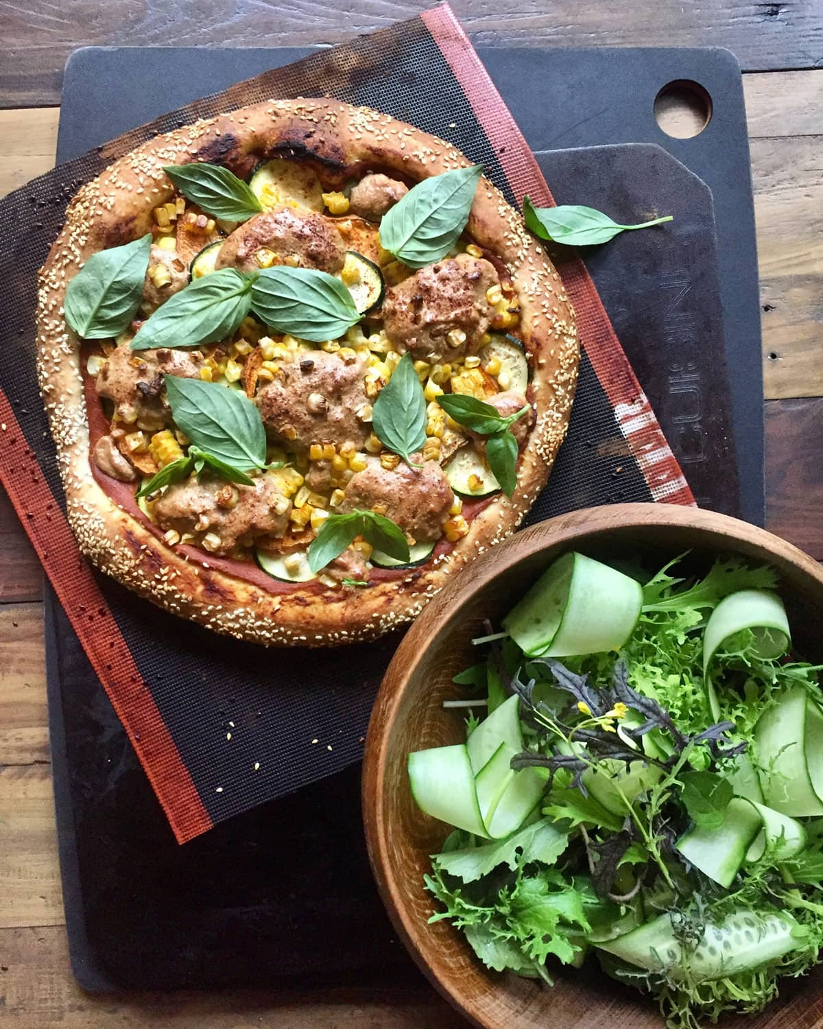 Image of vegan pizza with side of salad