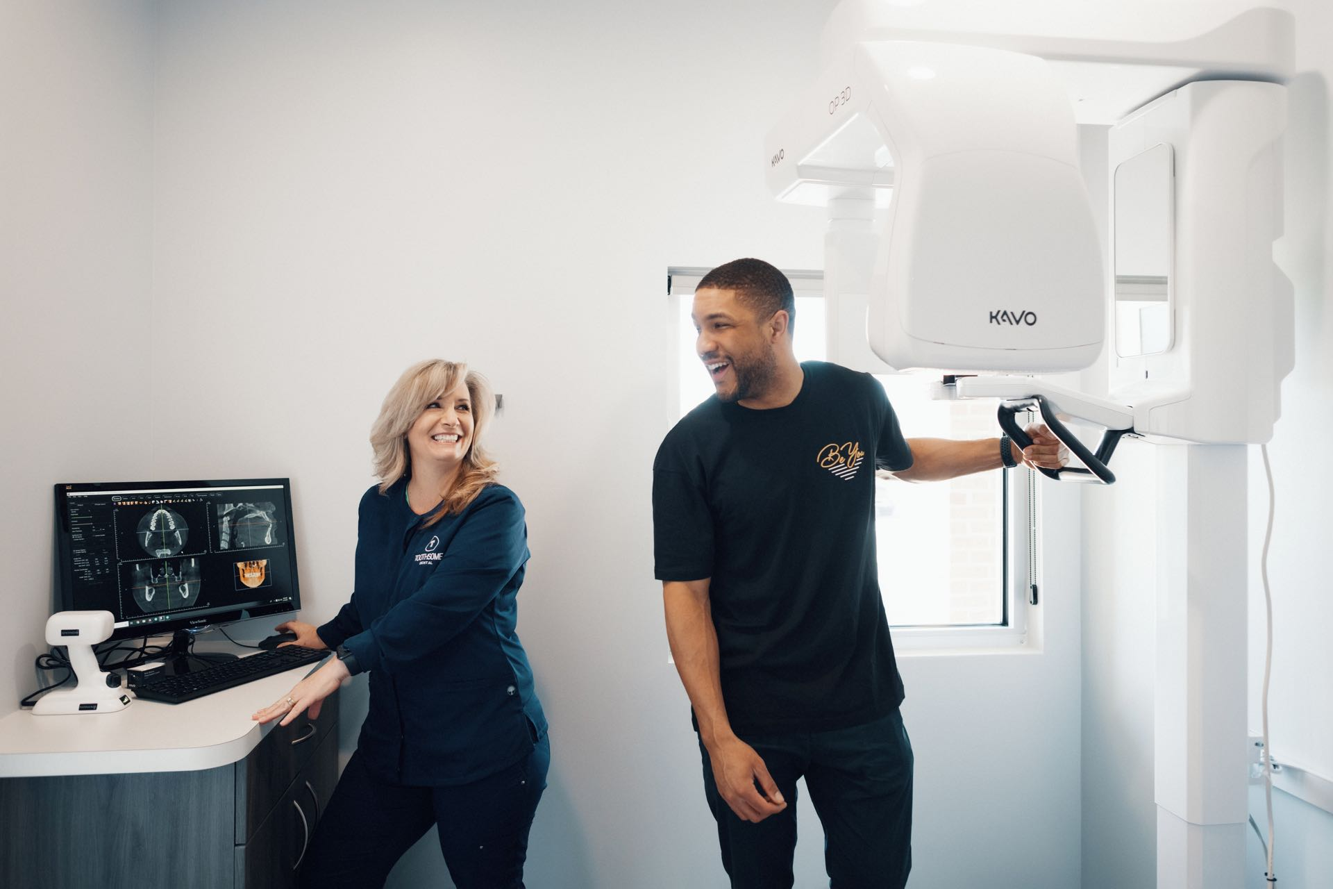 Photo of a Toothsome team member with a patient at the digital scanner