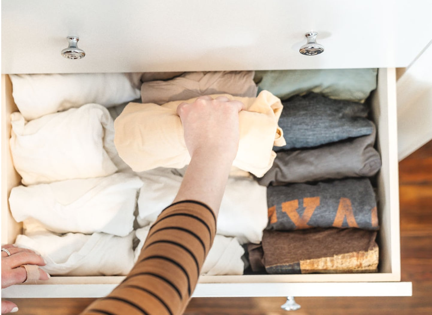 Drawer open with neatly folded clothes inside
