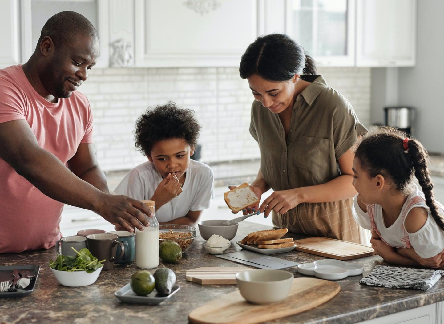 Family making breakfast in a kitchen