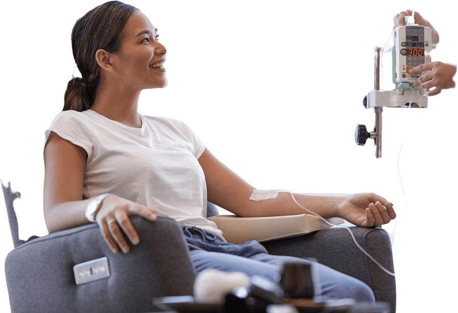 Woman smiling while receiving IV infusion therapy