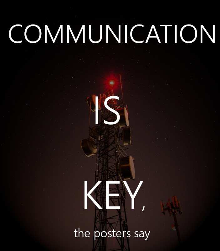 """A cheesy poster that says """"communication is key"""" over a radar antenna."""
