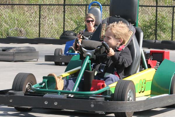 Little kid driving go-kart
