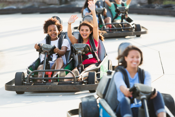 Teens riding go-karts