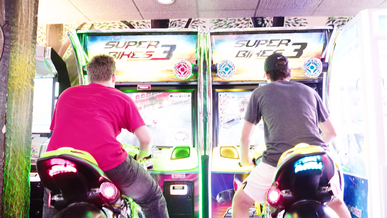 2 friends at the arcade