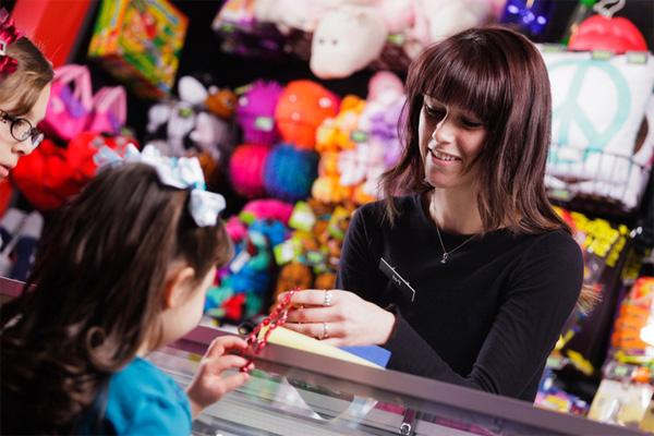 Girl winning prizes at arcade