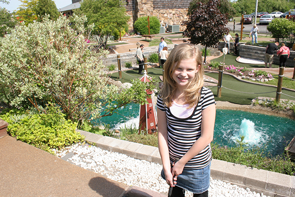Girl playing mini golf in Henrietta