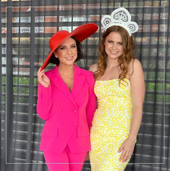 customers-wearing-elliatt-pink-suit-pasduchas-yellow-dress-premium-gift
