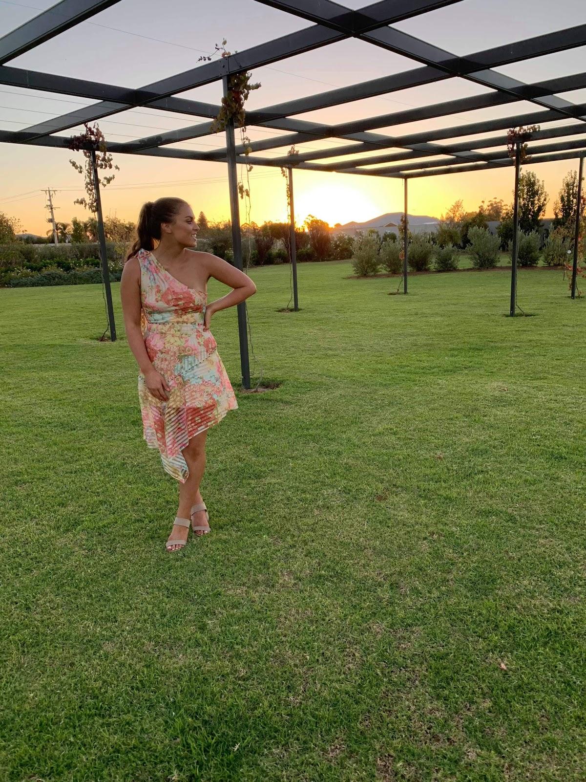 customer-wearing-talulah-floraison-midi-dress-sunset